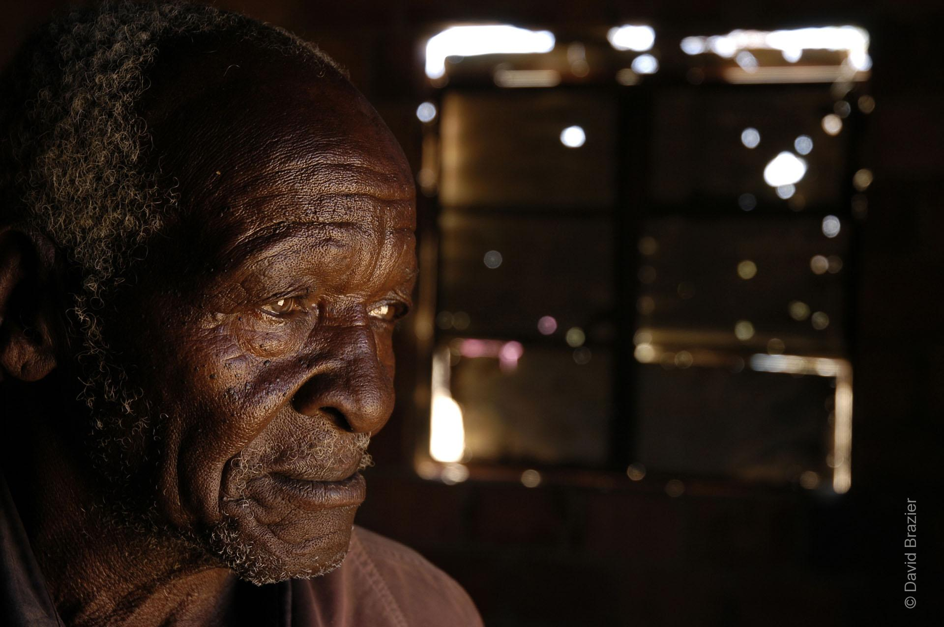 Elderly African man looking sad