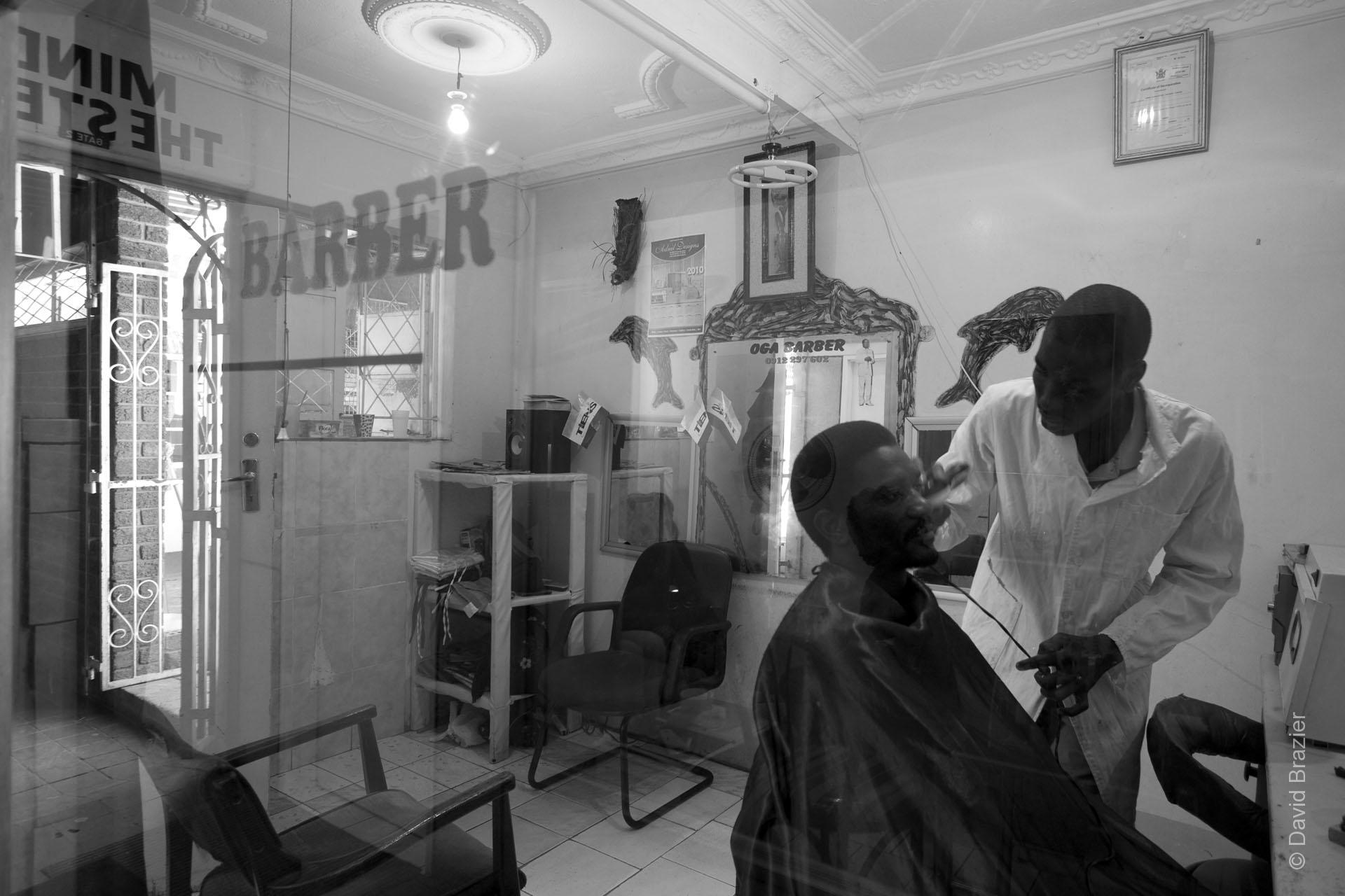 Black and white image of barber shop in Harare