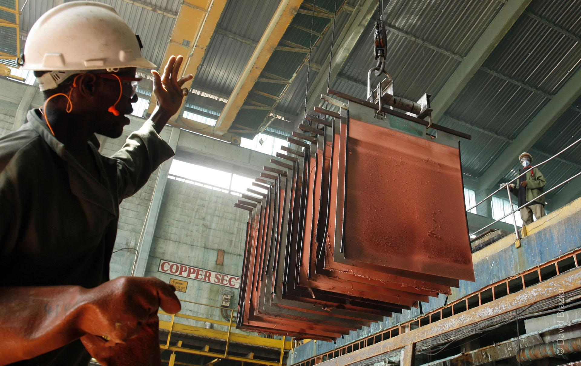 African factory worker in copper refinery