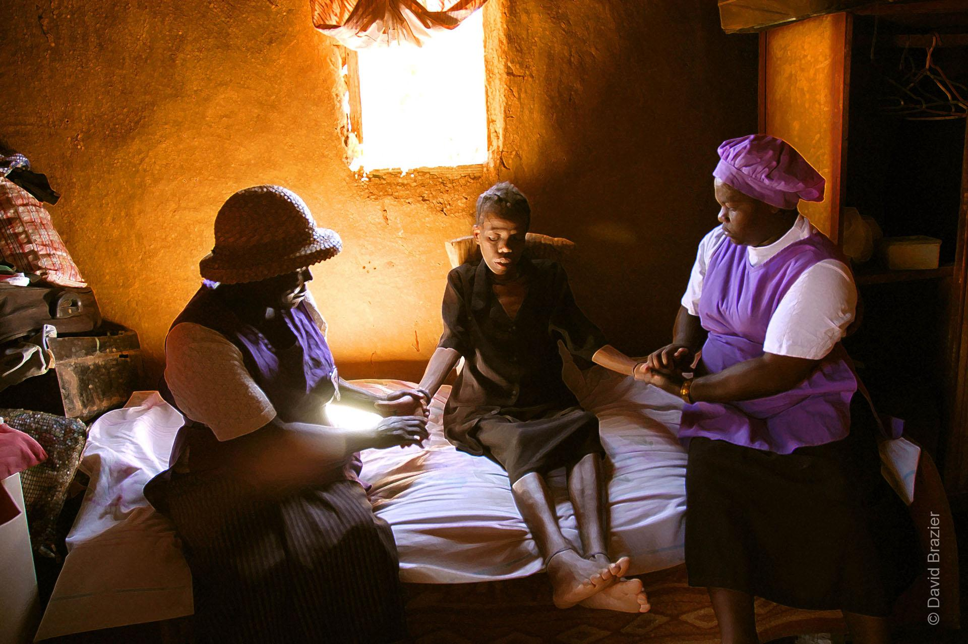 Homebased care volunters helping HIV/AIDS patient Zimbabwean home