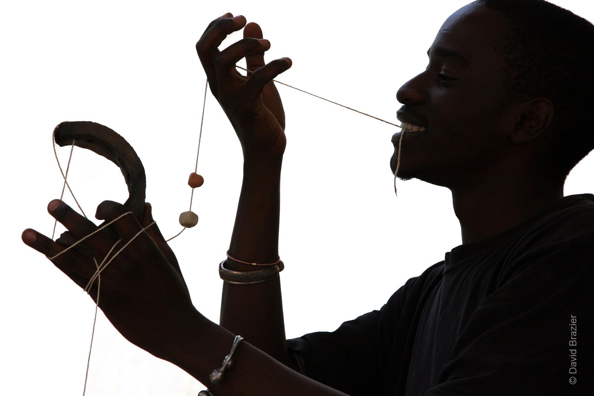 Portrait of Zimbabwean artist, Masimba Hwati, making a sculpture