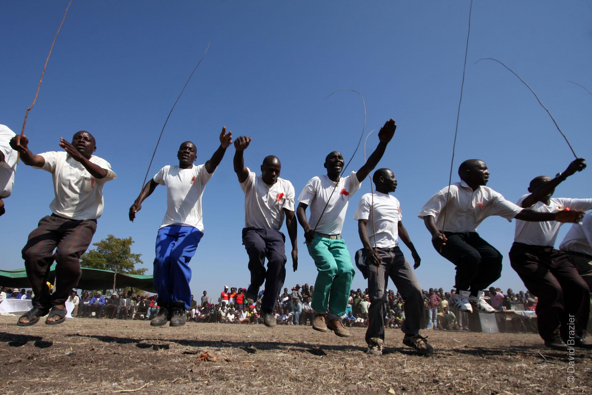 Shangaan men dancing with whips