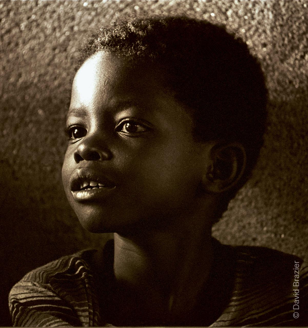 Sepia image of African child in a street